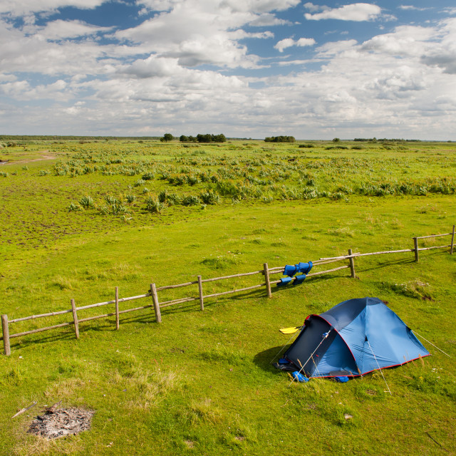 """""""Camping tent and grass expanse landscape"""" stock image"""