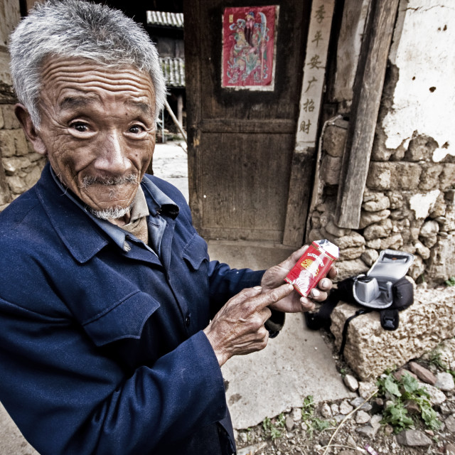 """Man in Baisha, Yunnan Province, China"" stock image"