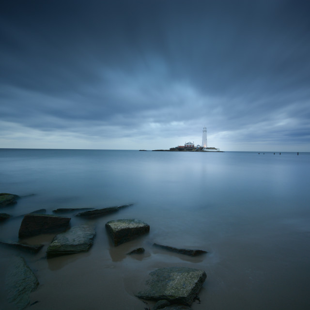 """Lighthouse under moving Clouds"" stock image"