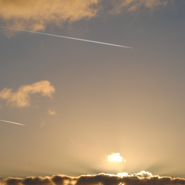 """Vapour trail at dusk 2"" stock image"