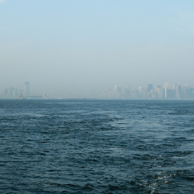 """Misty Manhattan. View of lower Manhattan Island from Staten Island Ferry"" stock image"