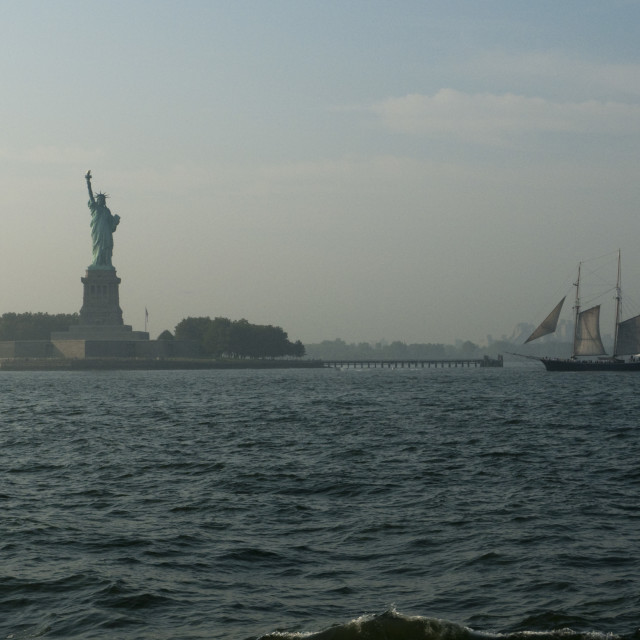 """Statue of Liberty and sailing boat, New York"" stock image"