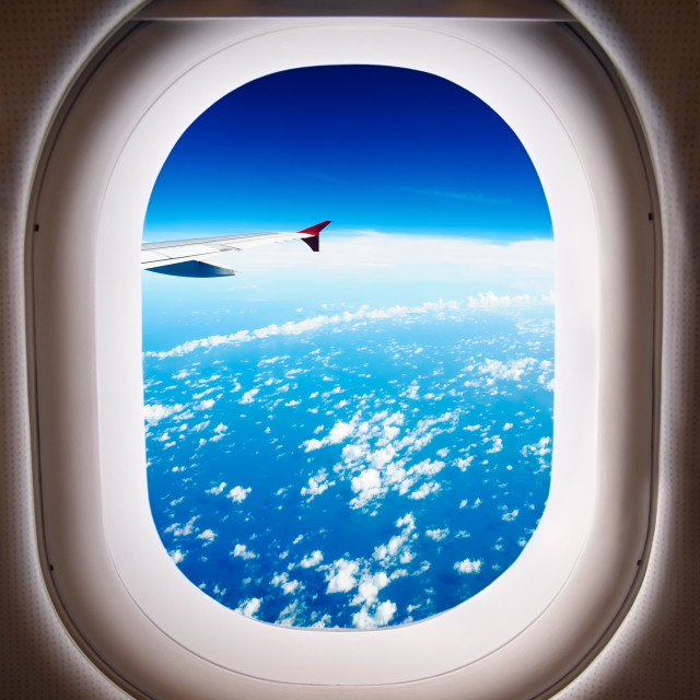 """Looking out of airplane window"" stock image"