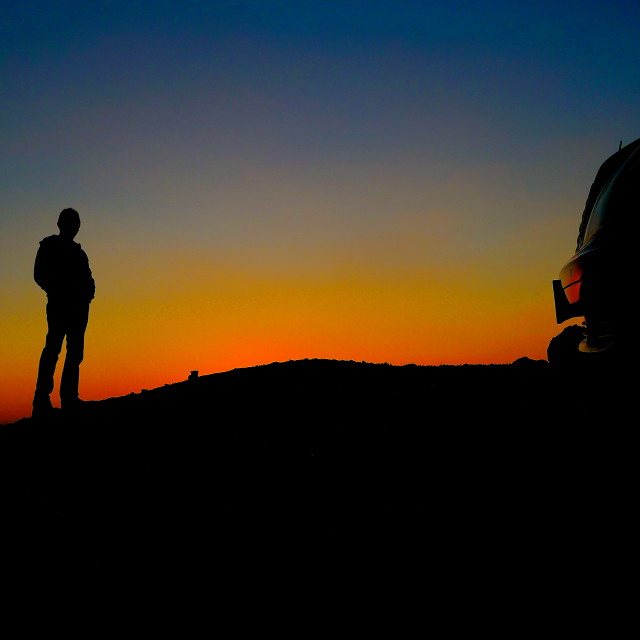 """""""A man, his car, and the sunset"""" stock image"""
