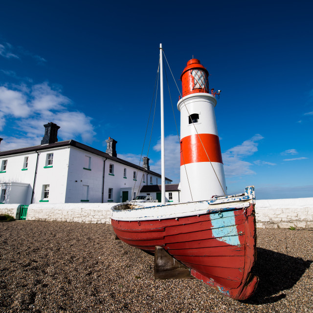 """""""Souter Lighthouse with boat and cottage."""" stock image"""