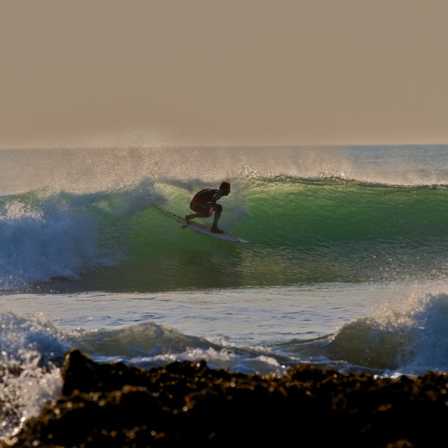 """""""Backlit Surfer"""" stock image"""