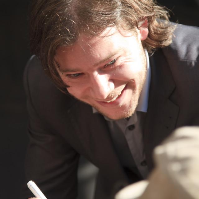 """Martijn Smit signing"" stock image"