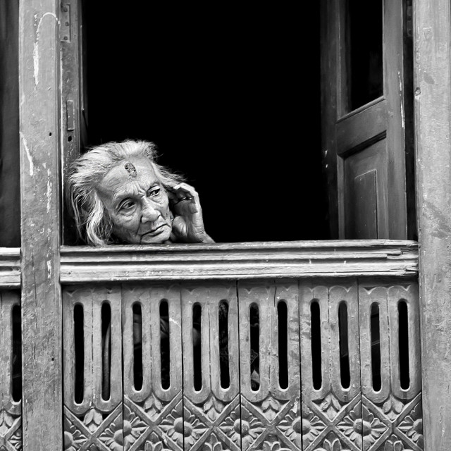 """AT THE WINDOW"" stock image"