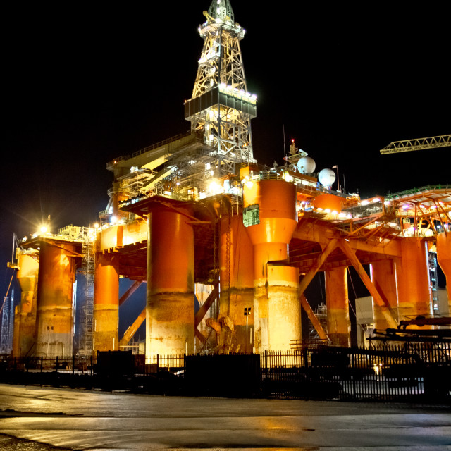 """Oil Rig At Night"" stock image"