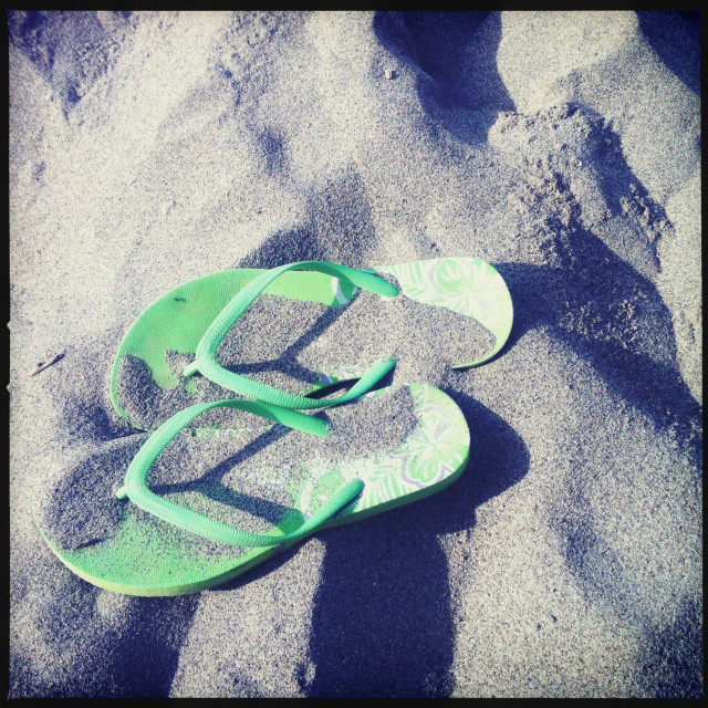 """Green flip flops on the sand"" stock image"