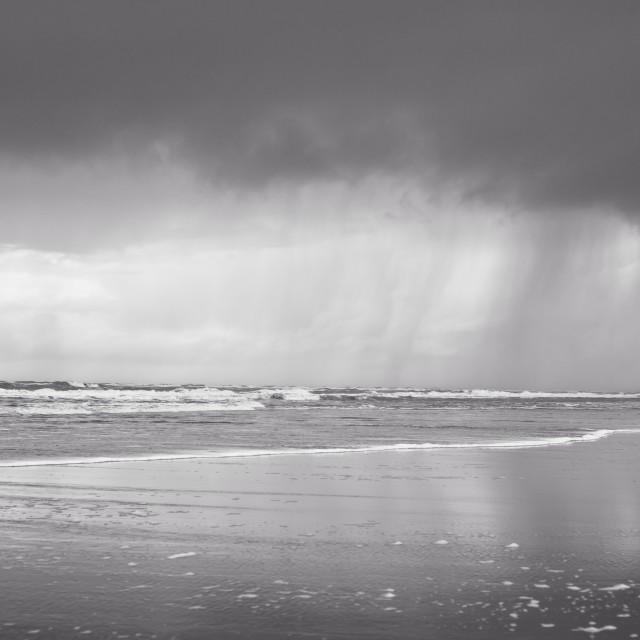 """Rain on the beach"" stock image"