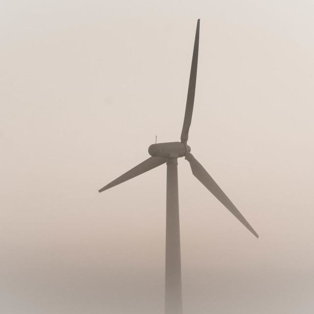 """Wind Generator in the Mist"" stock image"
