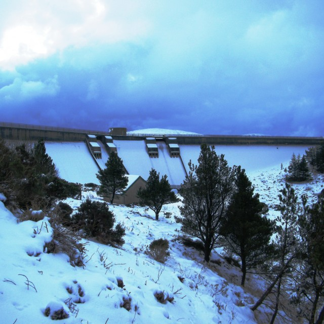 """Spelga Dam in the snow"" stock image"