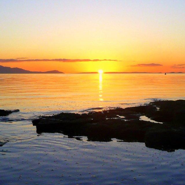 """Sunset over the Kintyre Peninsula"" stock image"