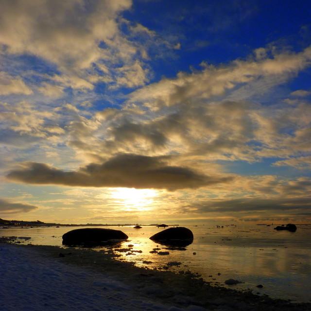 """Watery sunset over freezing Sea"" stock image"