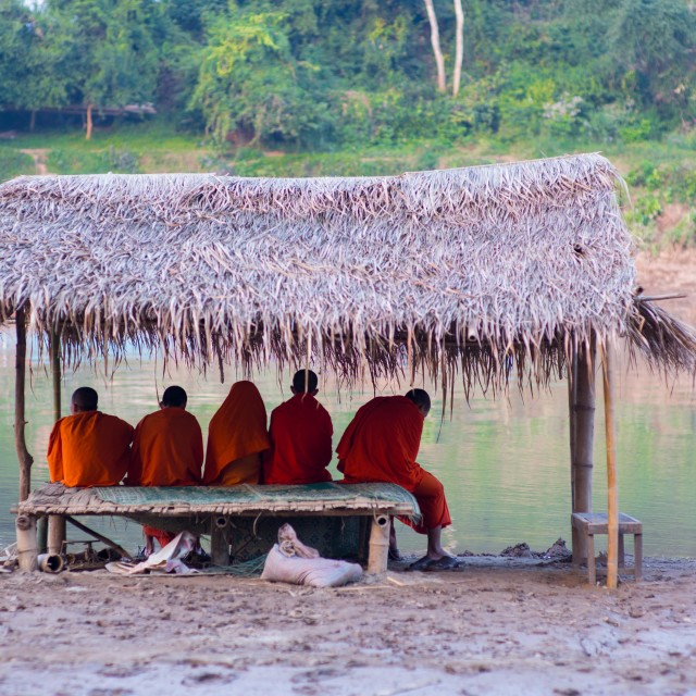 """Monks by the river"" stock image"