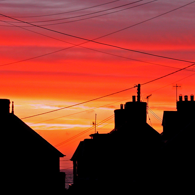 """Rooftops at sunset"" stock image"