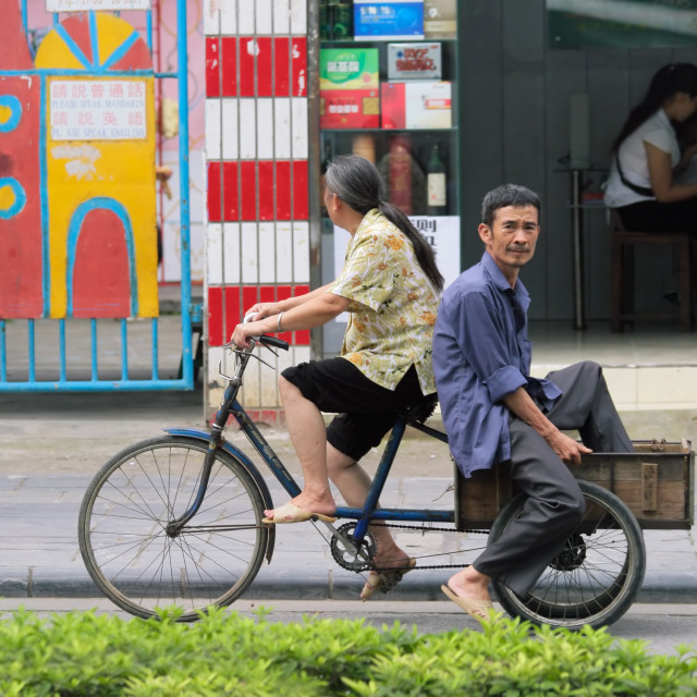 """Chinese couple on bicycle"" stock image"