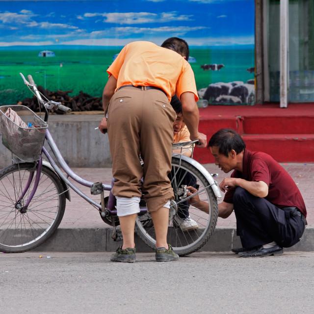 """""""Chinese men at work"""" stock image"""
