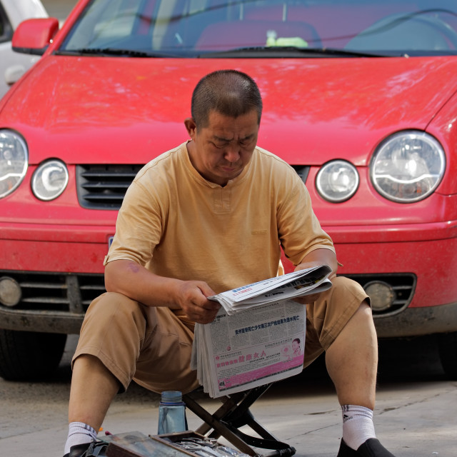 """Chinese man reading"" stock image"
