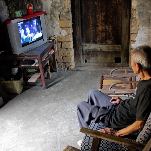 """Chinese man watching television"" stock image"