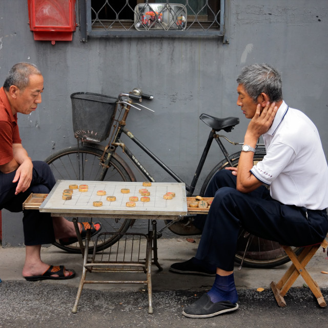 """Chinese men playing a board game"" stock image"