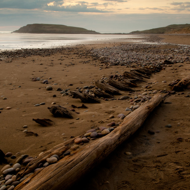 """Shipwreck on a Gower beach"" stock image"