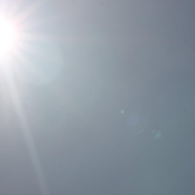 """Sunshine in blue sky"" stock image"
