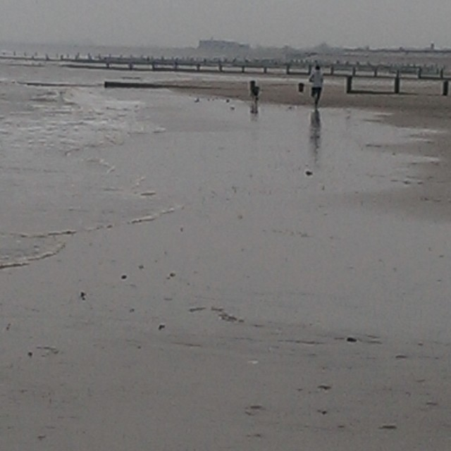 """Jog on a winter beach"" stock image"
