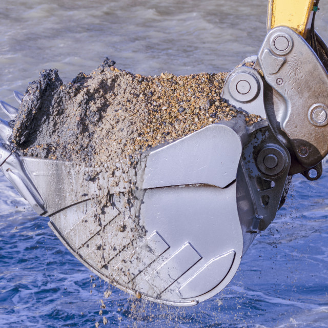 """""""Dredging with an excavator"""" stock image"""