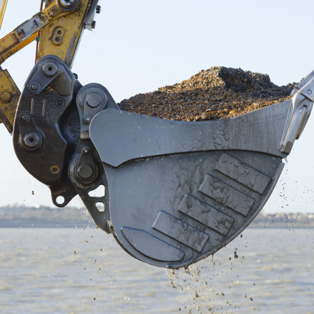 """Excavator dredging a harbor"" stock image"