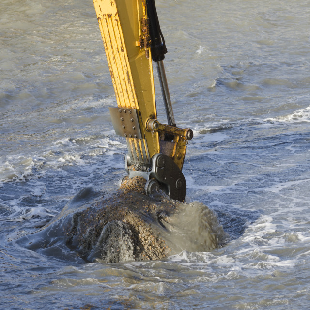 """Dredging with an excavator"" stock image"
