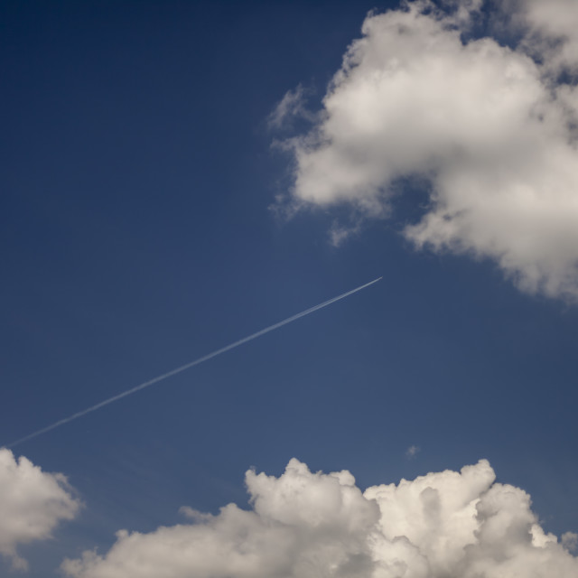 """Jet Airplane Flying Among Clouds"" stock image"