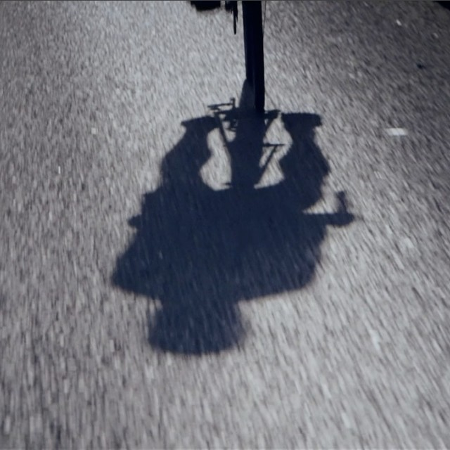 """Cyclist shadow"" stock image"