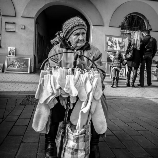 """Granny selling socks"" stock image"