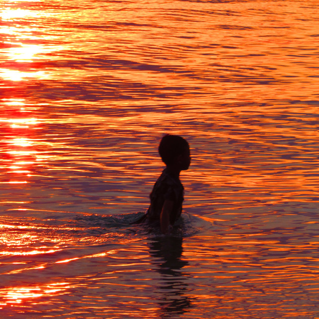 """Silhouette In The Sea At Sunset"" stock image"