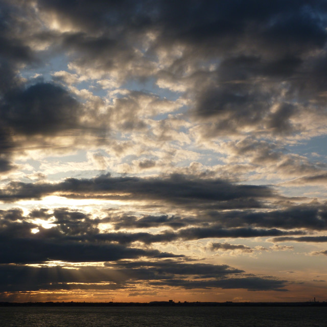 """""""Cloudy sunset over sea"""" stock image"""