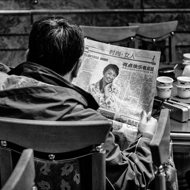 """Reading the paper"" stock image"