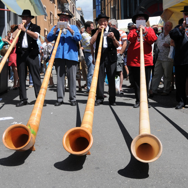 """Alpine horn playing"" stock image"