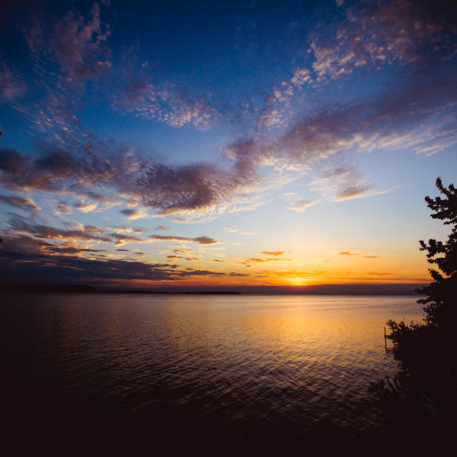 """""""Sunset as the clouds come in"""" stock image"""
