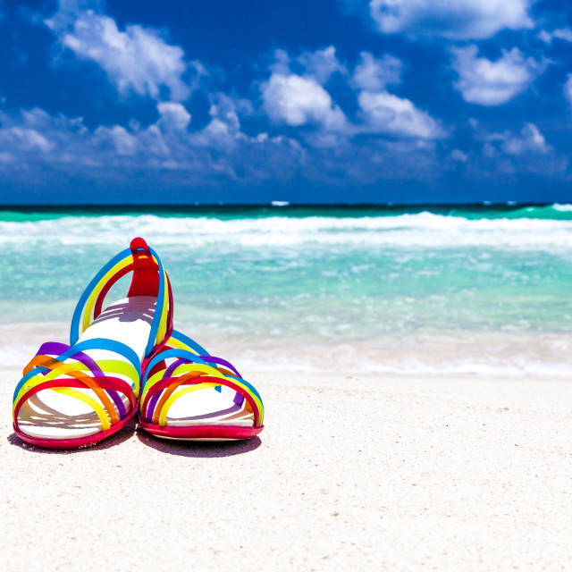 """Slippers on a beach"" stock image"