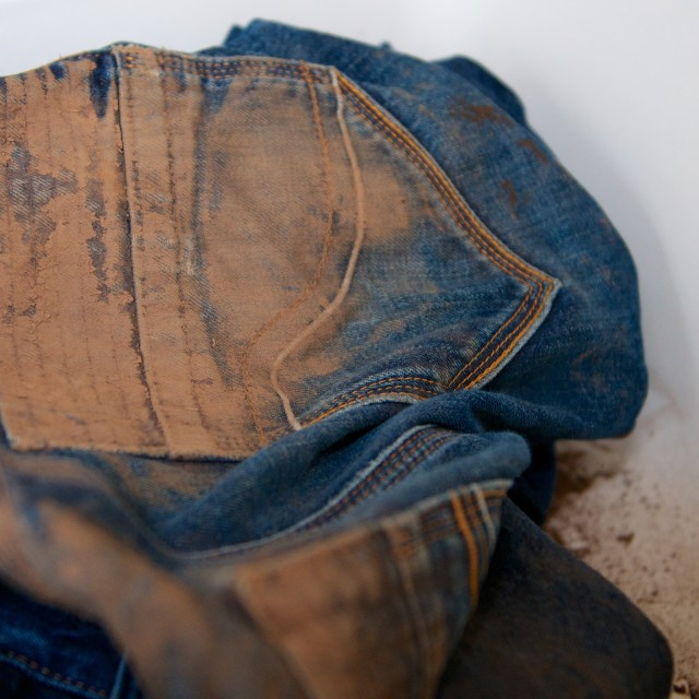 """Muddy jeans"" stock image"