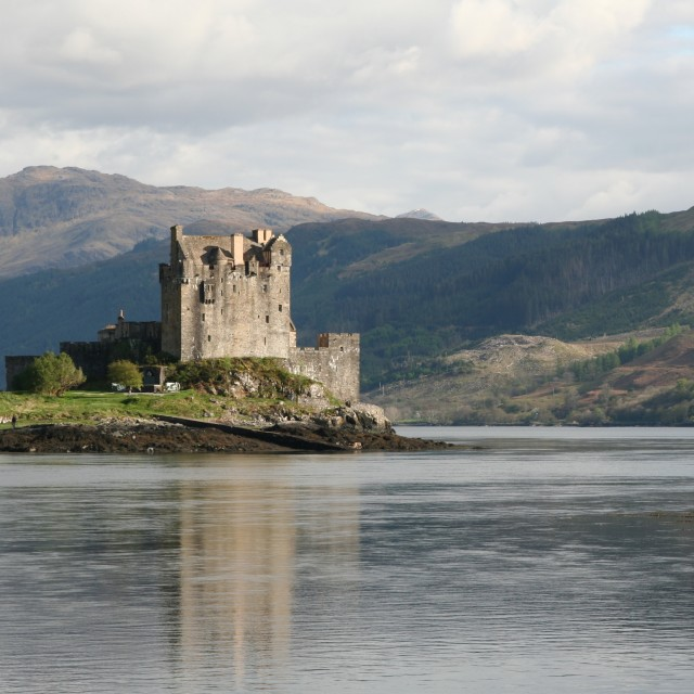 """Scottish castle on loch 2"" stock image"