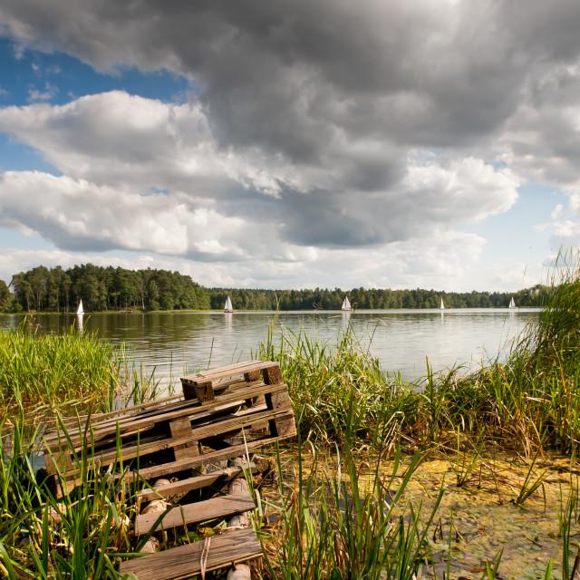 """""""Old bridge and boats at the lake"""" stock image"""