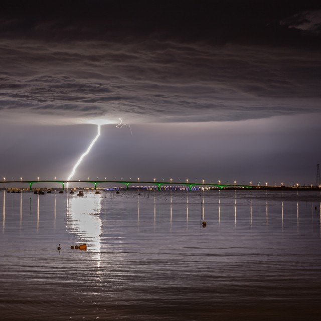 """Lightning over the bridge"" stock image"