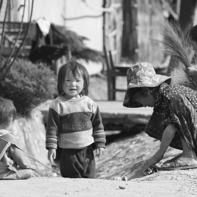 """""""Laos mother and children at work and play"""" stock image"""
