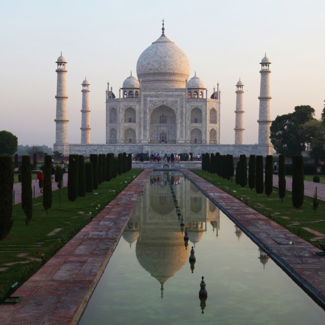 """Taj Mahal and reflective pool at dawn"" stock image"