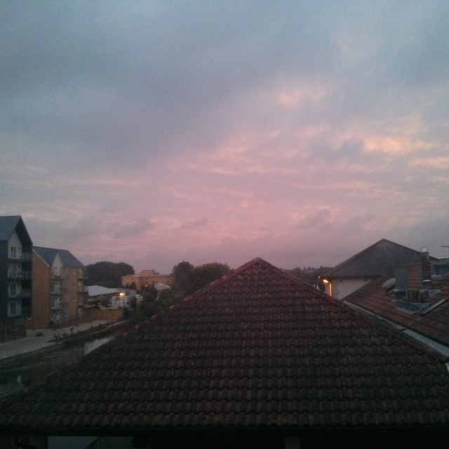 """A cloudy dusk over Chelmsford rooftops"" stock image"