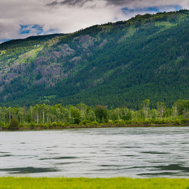 """Thompson River and mountains"" stock image"