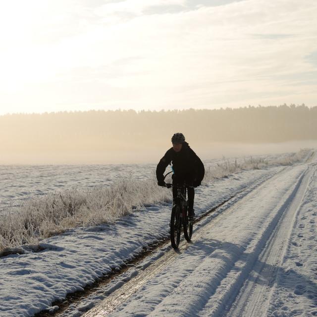 """Mountain Biker Braves Winter Weather."" stock image"